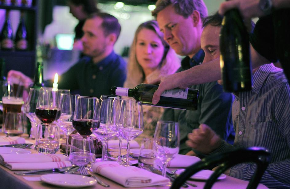 Pouring wine in brasserie Konrad.